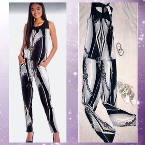 BCBG sleeveless Jumpsuit In white with black print